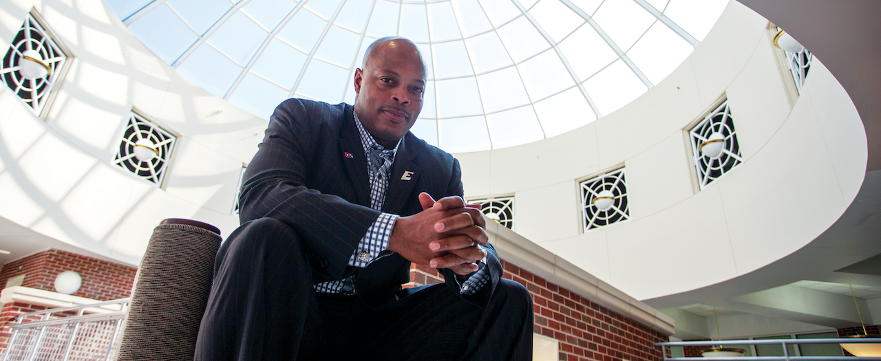 Troy Ellis sits under the glass dome in the College of Business and Technology